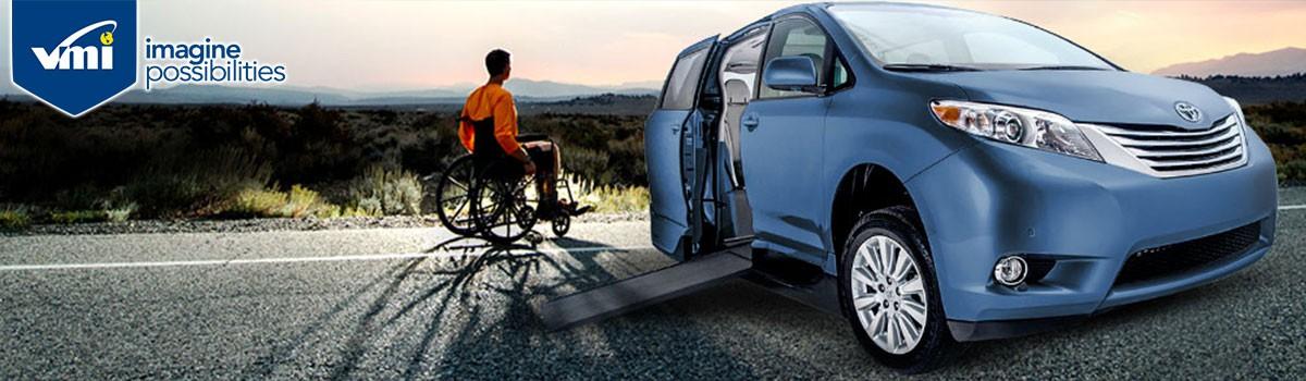 Boy next to wheelchair handicap van and enjoying it. Tyler  Texas Local Wheelchair Vans  Handicap Vans and Wheelchair